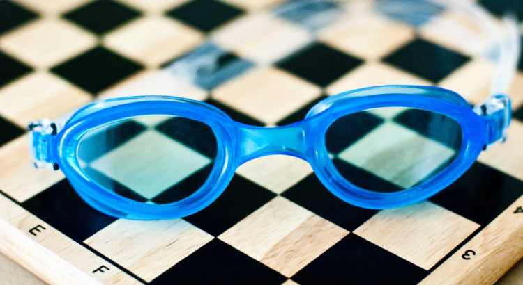 Swimming glasses on chess board http://barnimages.com/